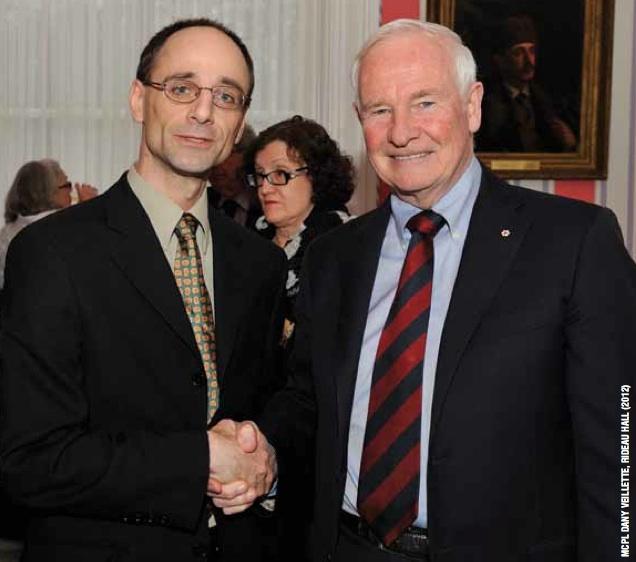 His Excellency the Right Honourable David Johnston congratulates Rat Creek Press editor Darren Boisvert at Rideau Hall in Ottawa